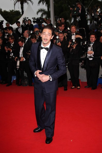 Adrien Brody in dark blue at the closing ceremony.