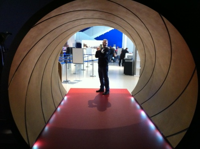 The entrance to the exhibit is cleverly designed as the iconic gun barrel used in the opening credits of most Bond films.