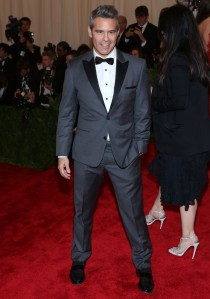 Like so many others, TV personality Andy Cohen threw off the look of a smart outfit by playing peek-a-boo with his shirt navel thanks to crotch-level trousers and a lack of waist covering.  The grey outfit was a nice match to his sal-and-pepper hair, though.  (WENN)