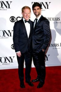 """Modern Family"" star Jesse Tyler Ferguson is also in midnight blue accessorized with a bow tie of his own design."