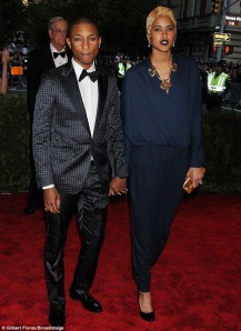 Singer/musician Pharrell WIlliams in a navy gingham-patterned tuxedo by Parisian luxury brand Lanvin.  (BroadImage)