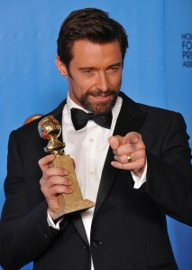 Hugh Jackman in Louis Vitton link-front at the 2013 Golden Globes (PA Images)