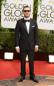 Michael Fassbender throws off a smart Tom Ford tuxedo with overly long shirt sleeves and trouser legs. (Jason Merritt/Getty Images)