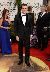 Ferguson's co-star Ty Burrell in a striking tuxedo that would look so much better if it fit properly.   (Jason Merritt/Getty Images)