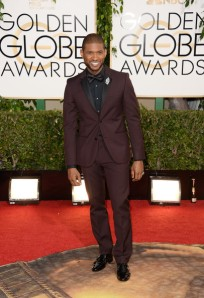 Singer Usher's outfit was on a lot of critics' best-dressed lists but with its total lack of contrast it's certainly not going to make mine.   (Jason Merritt/Getty Images)