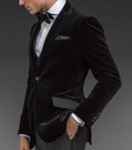 "One-button black velvet ""Phillip"" dinner jacket with peak lapels, grosgrain hacking pockets and side vents.  $1,687."