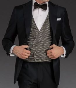 One-button peaked lapel tuxedo made of Italian wool with grosgrain facings.  $1,987.
