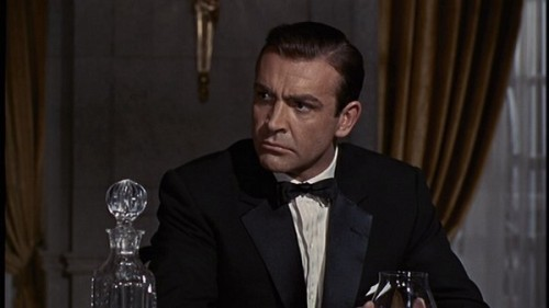 Sean Connery dinner jacket in 1964's Goldfinger is one of the most cited examples of notch lapel legitimacy.  However, the scene's context suggests otherwise.