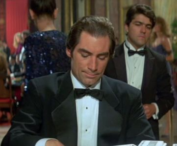 Wide lapels returned to popularity in the 1980s greatly exaggerating the droopy look of notched lapels.  Seen here is Timothy Dalton, the worst dressed of all the Bonds.