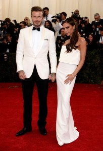 David Beckham characterizes the white dinner jacket multitude. (Dimitrios Kambouris / Getty)