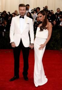 David Beckham characterizes the white dinner jacket multitude. (Dimitrios Kambouris / Getty)