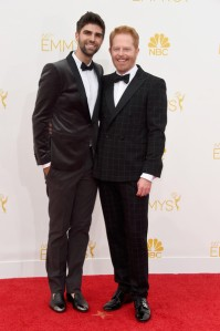 Modern Family actor Jesse Tyler Ferguson and husband Justin Mikita in Etro suits.  Ferguson's window pane pattern is interesting but ultimately too casual for black tie.  (Frazer Harrison/Getty Images North America)