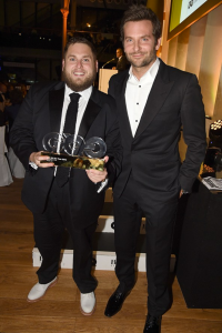 Jonah Hill with Bradley Cooper: a great example of the difference between dressing up and dressing well.  Even with his open-necked shirt, Cooper still pays more deference to the evening's elegance by respecting all the other rules of formal attire.  (Rex Features)