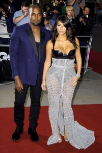 Kanye West's taste in formal attire is as classy as his taste in wives. (Rex Features)
