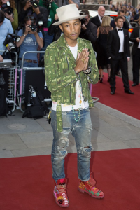Pharrell Williams is obviously much too cool to give a rat's ass about the event's black-tie dress code.  (PA Photos)
