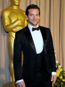 Bradley Cooper, seen here at the 2010 Oscars, is another Tom Ford aficionado.   For manages to elevate the mundane notch lapel and two-button jacket cut with the addition of a rakish low-cut waistcoat.